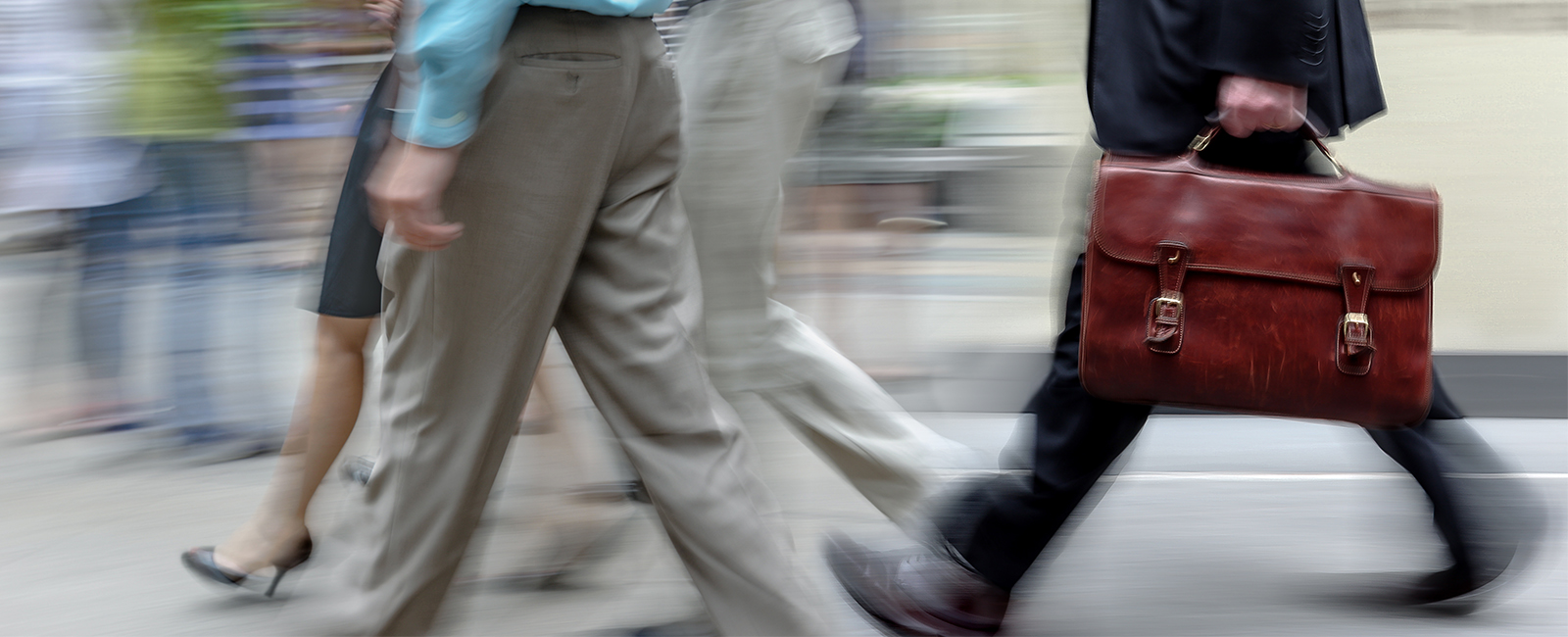 executives walking quickly waist and lower leg view
