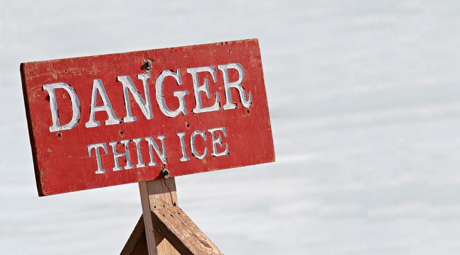 Danger Thin Ice sign on ice pond