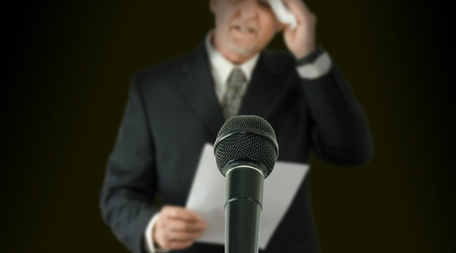 Man at Microphone with a Fear of Public Speaking